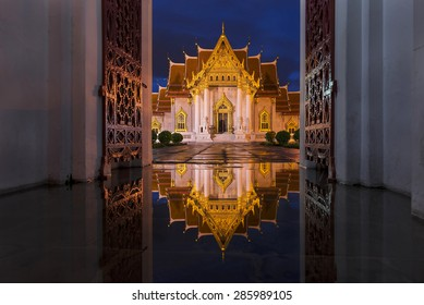 Wat Benchamabophit in Bangkok at twilight time with reflection o