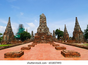 Wat Chaiwattanaram temple in Ayutthaya Historical Park at daytime. On blue sky and white cloud background, Thailand