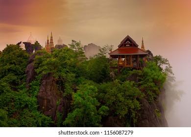 Wat Chaloem Phrakiat Phrachomklao Rachanuson, Chae Hom Picture, Pagoda on rock mountain in the morning, when sunrise very beautiful. Lampang, Thailand.