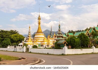 Wat Chong Klam and Wat Chong Klang are the most famous landmarks of Mae Hong Son in Thailand. (Name of place is Chong Klang Temple words on board)