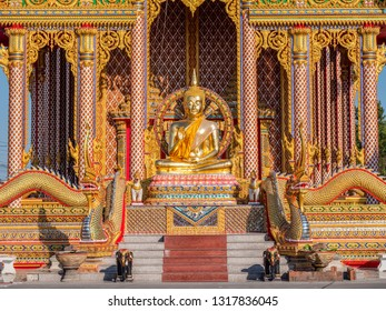 Wat Huai Yai, a Buddhist temple with a golden Buddha image in front of it in Huai Yai, close to Pattaya City in Chonburi, Thailand.