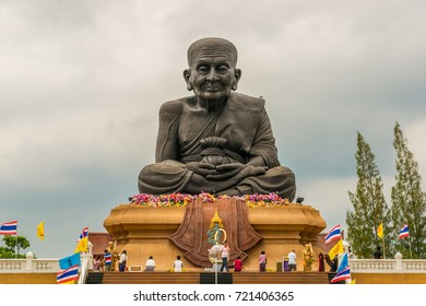 Wat Huay Mongkol, Thailand - November 14th, 2014: Many local people come to visit and for praying at the giant statue of the famous monk Luang Phor Thuad at Huay Mongkol Temple nearby Huan Hin.