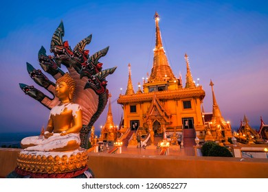 Wat Khiri Wong or Chulamani temple, Nakhonsawan province, golden temple with Buddha Sheltered by Naga Hood, Temple on the mountain, Landmark in Thailand