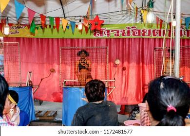 Wat Krok Krak , Samut Sakhon Thailand January 3,2018 : The annual festival, Thai play called Dunk tank girl held for fun in Thailand
