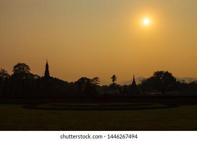 Wat Maha That temple against sunset, Sukhothai, Thailand