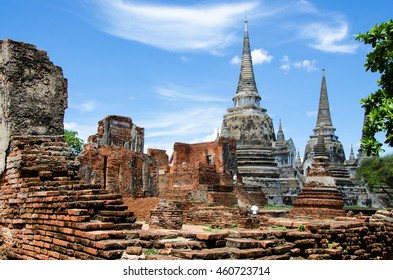 WAT MAHATHAT AT AYUTHAYA HISTORICAL PARK , AYUTHAYA PROVINCE, THAILAND , THE FAMOUS RUINS OF THE ANCIENT TEMPLE AND PALACE