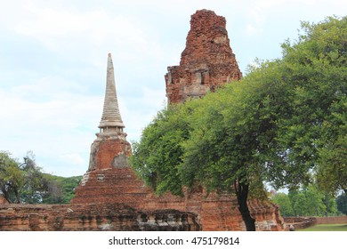 Wat Mahathat ,Buddhist sculpture ,Thai temple ,ancient architecture ,Thai temple architecture ,Ayutthaya Historical Park,Thailand ,world heritage.  Buddha's head in tree roots is in this temple.