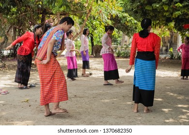 Wat Muang, Ban Pong, Ratchaburi -THAILAND, April. 15, 2019 : view of a man with traditional costume playing Saba (Mon traditional game) in Songkran Festival.