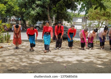 Wat Muang, Ban Pong, Ratchaburi -THAILAND, April. 15, 2019 : view a group of Mon children with traditional costume playing Saba (Mon traditional game) in Songkran Festival.