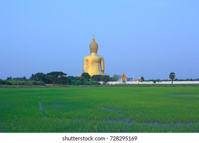 Wat Muang with head Buddha statue in Thailand