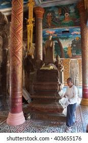 WAT NOKOR, CAMBODIA - FEB 9, 2015 - Buddhist altar in temple at Wat Nokor, 8th century,  Cambodia
