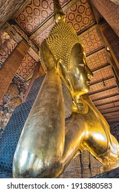 Wat Pho the reclining buddha in a temple in Thailand.