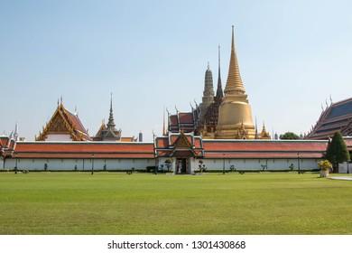 Wat Phra Kaew, Beautiful temple with green grass, Bangkok, Thailand, with blue sky.