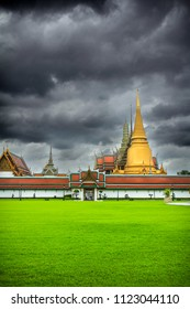 Wat Phra Kaew, Temple of the Emerald Buddha with cloudy sky in Bangkok, Thailand.