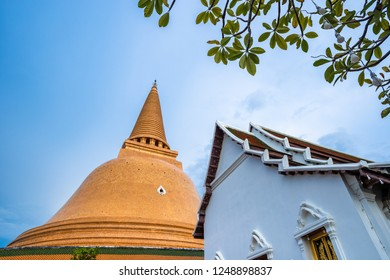 Wat Phra Pathom Chedi in blue sky, Thailand. Golden stupas.
