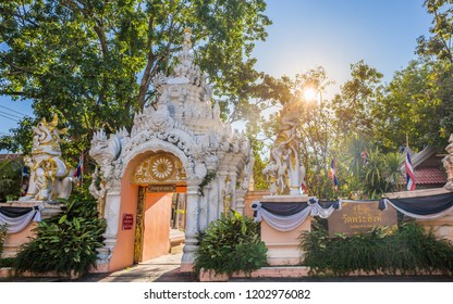"""Wat Phra Singh temple is a buddhist temple located in Chiang Rai, northern Thailand. Landmark of Chiang Rai, Translation text in the image """"Wat Phra Singh and Tha Luang Gate"""""""
