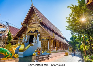 """Wat Phra Singh temple is a buddhist temple located in Chiang Rai, northern Thailand. Landmark of Chiang Rai, Translation text in the image """"please take off your shoes"""""""
