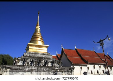 Wat Phra That Chang at noon under blue sky Background