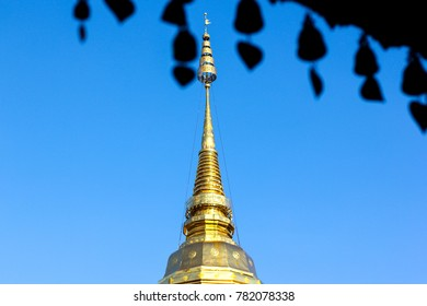 Wat Phra that Doi Suthep pagoda(Chiang mai) with small silhouette pagoda hanging from a roof.