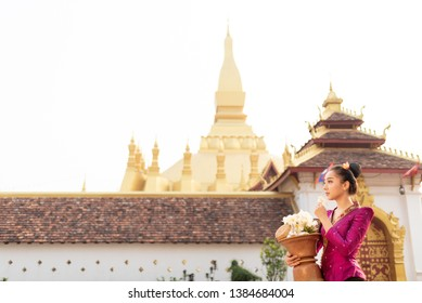 Wat Phra That Luang Lao girl dressed in traditional Lao clothes Beautiful Laos girl in Laos costume,Asian woman wearing traditional Laos culture,vintage style,traditional suit