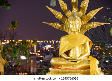 Wat Phra Yai Temple Buddha Statue Close-up with Pattaya city in the background Thailand