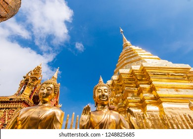 Wat Phrathat Doi Suthep is the most popular tourist attraction in Chiang Mai, Thailand. Sunny day with blue sky and white clouds.