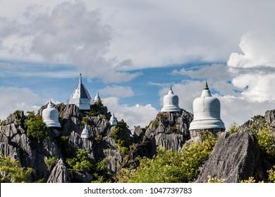 Wat Prajomklao Rachanusorn (Wat Phrabat Pu Pha Daeng) , Lampang province, Thailand. / Pagodas on mountain in thailand.