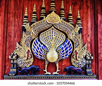 Wat Ram Poeng Tapotaram Temple, Mueang Chiangmai, Chiang Mai City, Thailand. February 22, 2018.  Peacock Sculpture on Church Wall