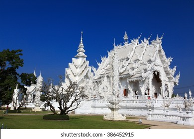 Wat Rong Khun : Holy white temple, one of the famous of Chiang Rai province, Thailand. Landscape shot with clear blue sky