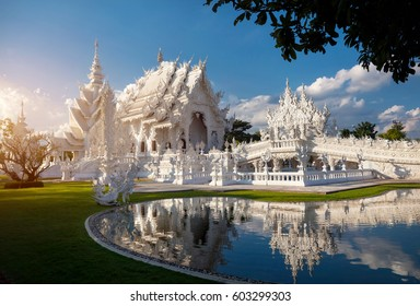 Wat Rong Khun The White Temple with reflection in the pond in Chiang Rai, Thailand.