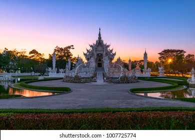 Wat Rong Khun(White temple)at sunset in Chiang Rai,Thailand.23/01/2018 Wat Rong Khun is modern building, well known worldwide.It was designed by Chalermchai Kositpipat.Opened it to visitors in 1997.