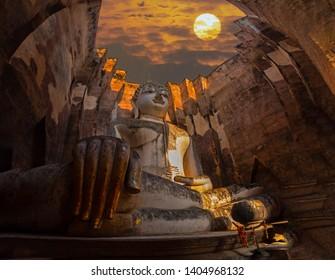 Wat Si Chum in Sukhothai Historical Park is a historic site big statue of Buddha Phra Achana Sukhothai in asia Thailand.