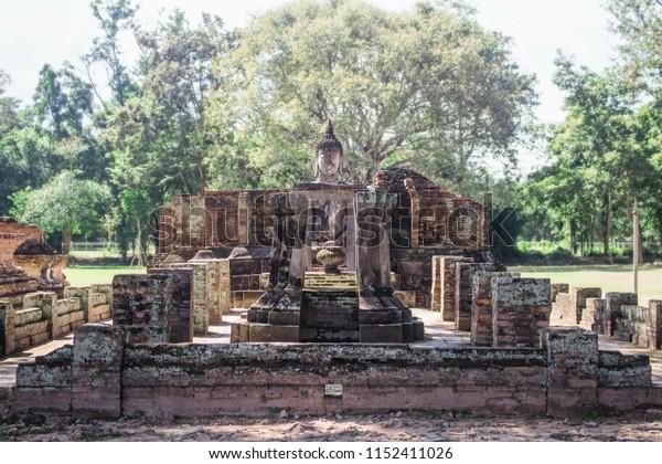 Wat Si Chum temple ruins with sitting buddha statue. Sukhothai Historical Park, Thailand