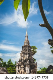 Wat That Ing Hang temple in Savannakhet, Laos. Old buddhist temple in Asia. Temple in natural frame made by old tree