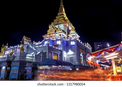 Wat Traimit, Bangkok, Thailand-Feb 19, 2019:The devout Buddhists walking with lighted candles in hand around a temple candle light trail of Buddhism Ceremony at temple ruin on Makha Bucha Day.