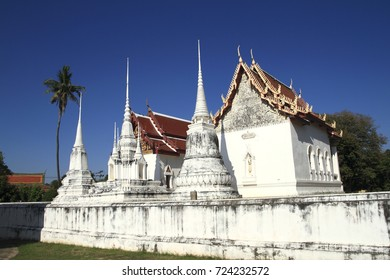 Wat Uposatharam at noon under blue sky Background