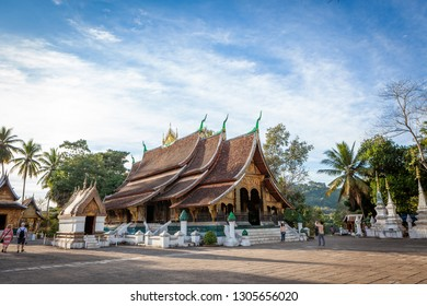 Wat Xieng Thong Temple (Golden City Temple) in Luang Prabang on a sunny day, December 2018