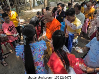 Wat Yai Nakhon Chum, Ban Pong, Ratchaburi -THAILAND, Oct. 13, 2019 : Buddhist Lent Day, view of buddhist women with traditional costume make merit offering food to a monk.