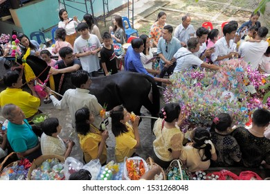 Wat Yai Nakhon Chum, Ban Pong, Ratchaburi -THAILAND, Oct. 13, 2019 : Buddhist Lent Day, view of a black horse pulling a cart full of many Thai money around with many Thai buddhist people.