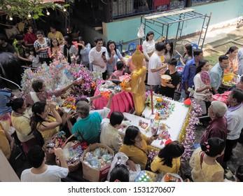 Wat Yai Nakhon Chum, Ban Pong, Ratchaburi -THAILAND, Oct. 13, 2019 : Buddhist Lent Day, view of many Thai Buddhist people make merit giving money and putting money into a cart.