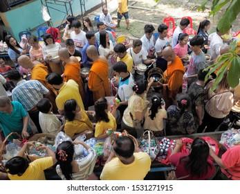 Wat Yai Nakhon Chum, Ban Pong, Ratchaburi -THAILAND, Oct. 13, 2019 : Buddhist Lent Day, Top view of many Thai Buddhist people make merit to many monks.