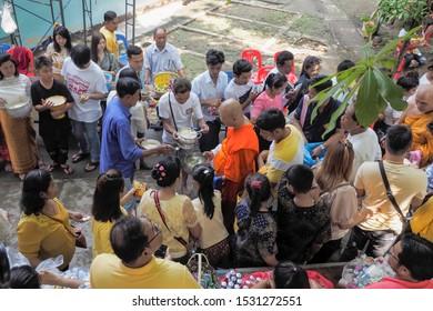 Wat Yai Nakhon Chum, Ban Pong, Ratchaburi -THAILAND, Oct. 13, 2019 : Buddhist Lent Day, Top view of many Thai Buddhist people make merit to a monk.