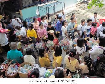 Wat Yai Nakhon Chum, Ban Pong, Ratchaburi -THAILAND, Oct. 13, 2019 : Buddhist Lent Day, view of many Thai buddhist people with tradition costume make merit to buddist temple.