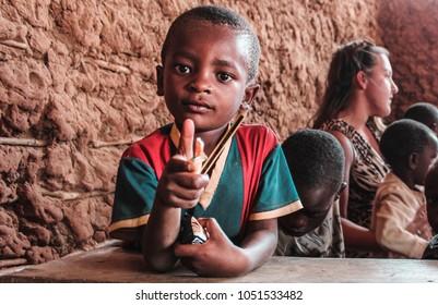 Watamu, Kenya/ Africa - 08/15/2015: African baby mimics a gun