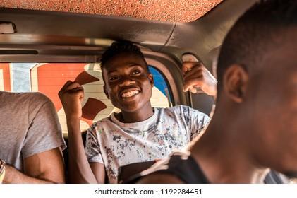 Watamu, Kenya - August 2018 - Happy young black boy inside a bus.