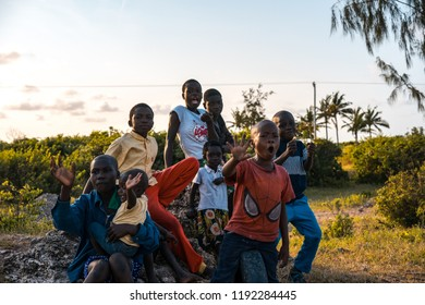 "Watamu, Kenya - August 2018 - Young black boys and girls at the side of a road saying ""hello"" to tourist."