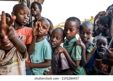 Watamu, Kenya - August 2018 - Young boys and girls happy to see tourist and waiting to receive some gifts.