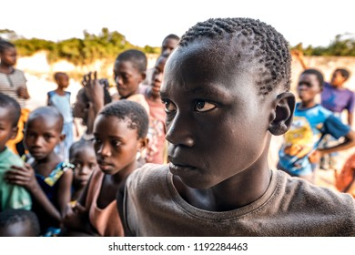 Watamu, Kenya - August 2018 - Young black boy in the crowd listening to someone.
