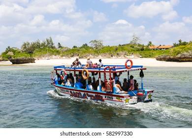 WATAMU, KENYA - January 15, 2017:Tourists exploring Watamu marine park on tour boat.
