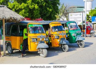WATAMU, KENYA - January 22, 2017: Tuk Tuk taxi on street of Watamu.